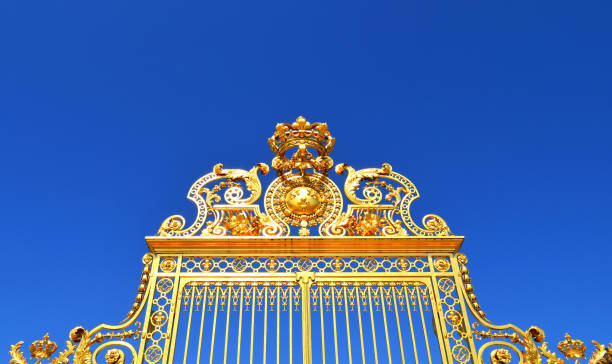 Closeup of Versailles Palace gate with crown stock photo