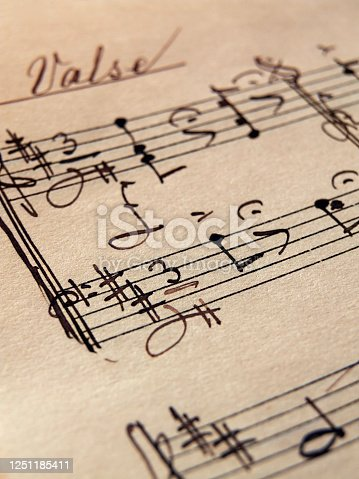 istock Closeup of vintage music sheets on old yellow paper 1251185411
