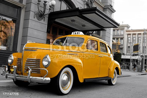 Old model yellow taxi