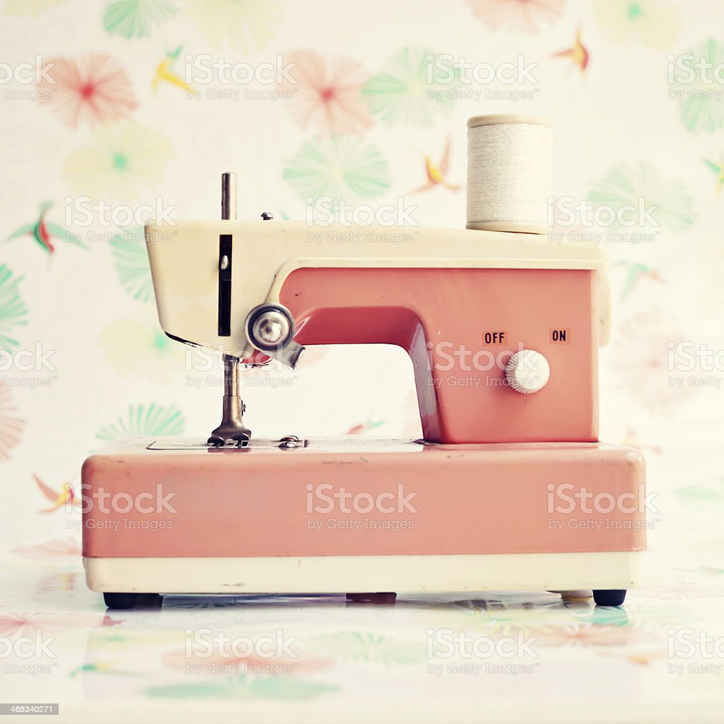 Close-up of vintage pink toy sewing machine stock photo
