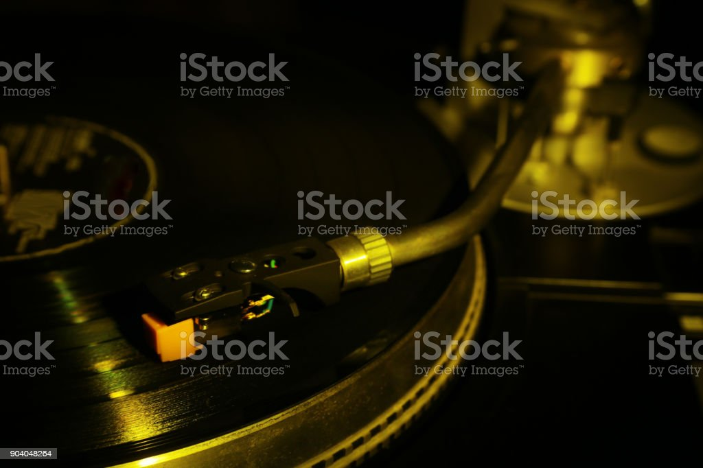 closeup of vinyl turntable, hi-fi headshell cartridge in action, Retro gramophone playing analog disc with music. place for text. – zdjęcie