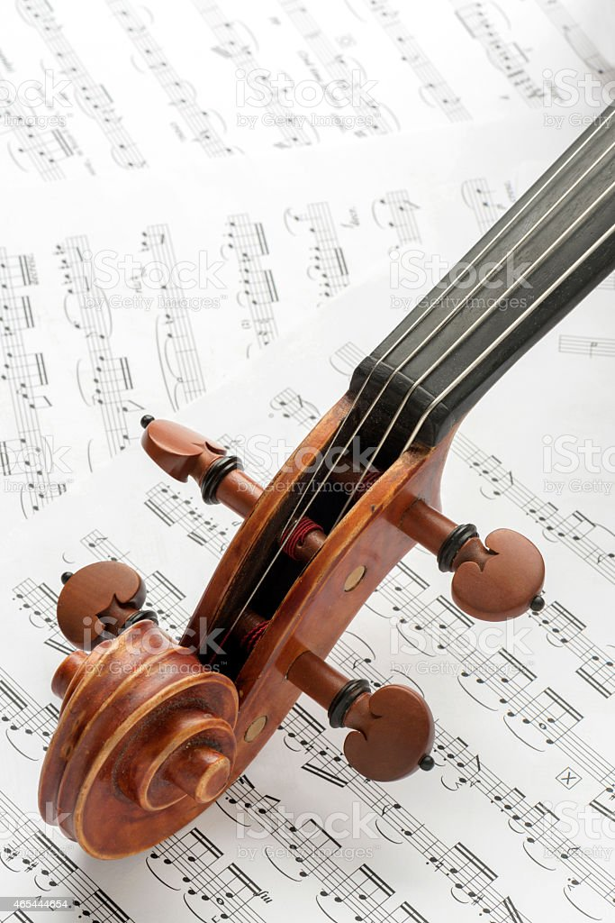 Close-up of Viola and Bow on Sheet Music Papers Background stock photo