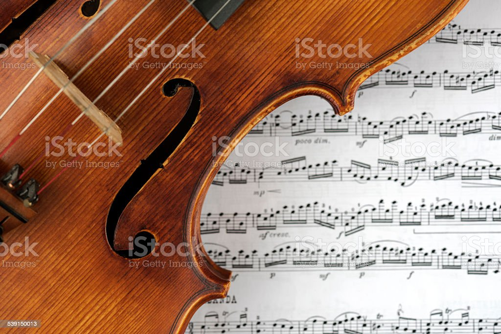 Close-up of Viola on Sheet Music Papers Background stock photo