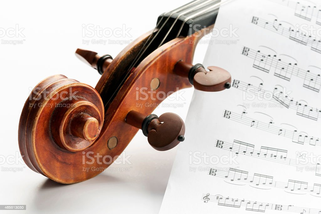 Close-up of Violin with Sheet Music Paper on White Background stock photo