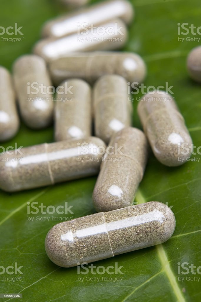 Close-up of vitamins on green leaf royalty-free stock photo