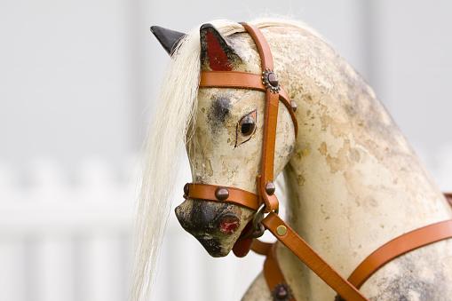 Close-up of vivid white antique rocking horse