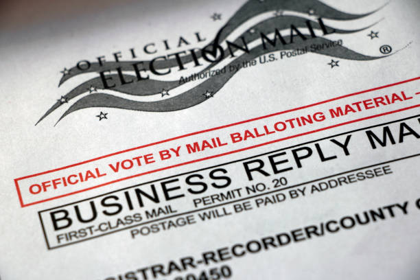 Closeup of Vote by Mail envelope Closeup of a Vote by Mail envelope, official balloting material - business reply mail, USPS first class mail. election stock pictures, royalty-free photos & images