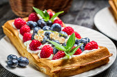 Closeup of waffles with fresh berry fruit.