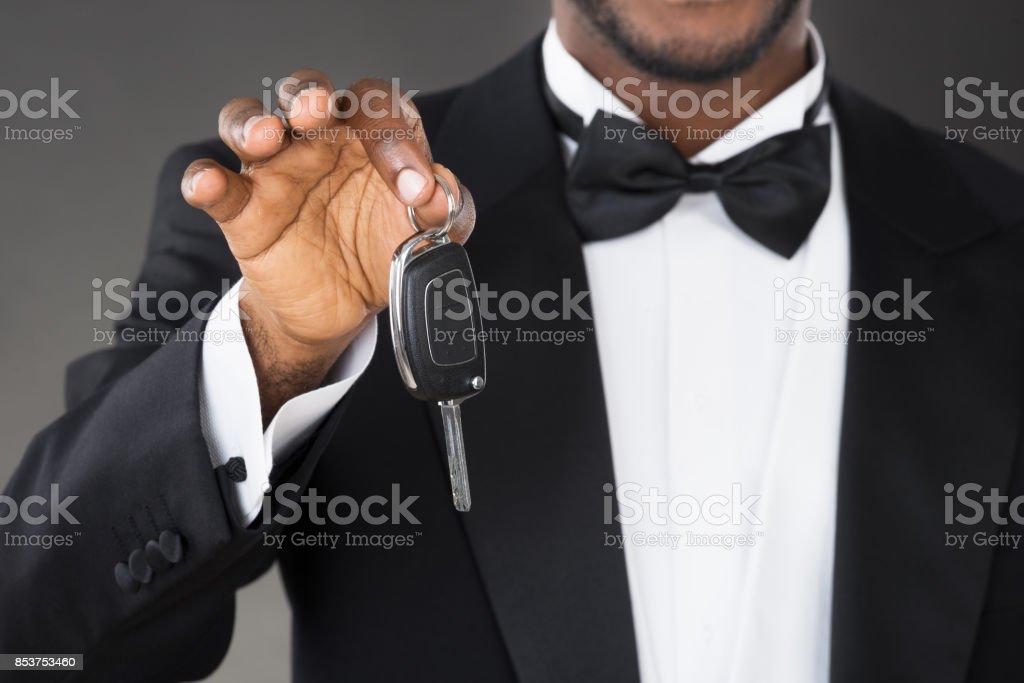 Close-up Of Waiter Holding Car Key stock photo