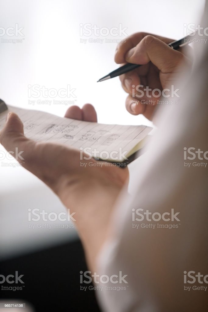 Close-up of waiter taking order - Royalty-free 20-29 Years Stock Photo