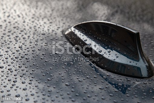 881639308istockphoto Closeup of water droplets on a car fin antenna 1141711900
