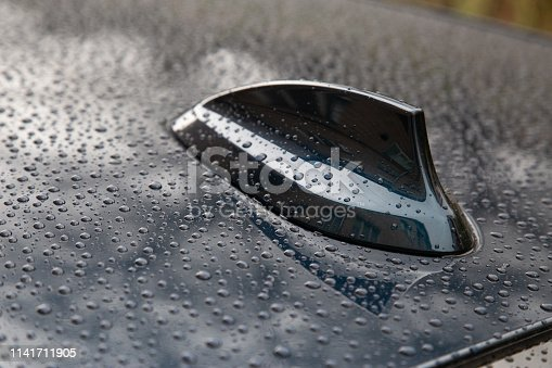 881639308istockphoto Closeup of water droplets on a car fin antenna 1141711905