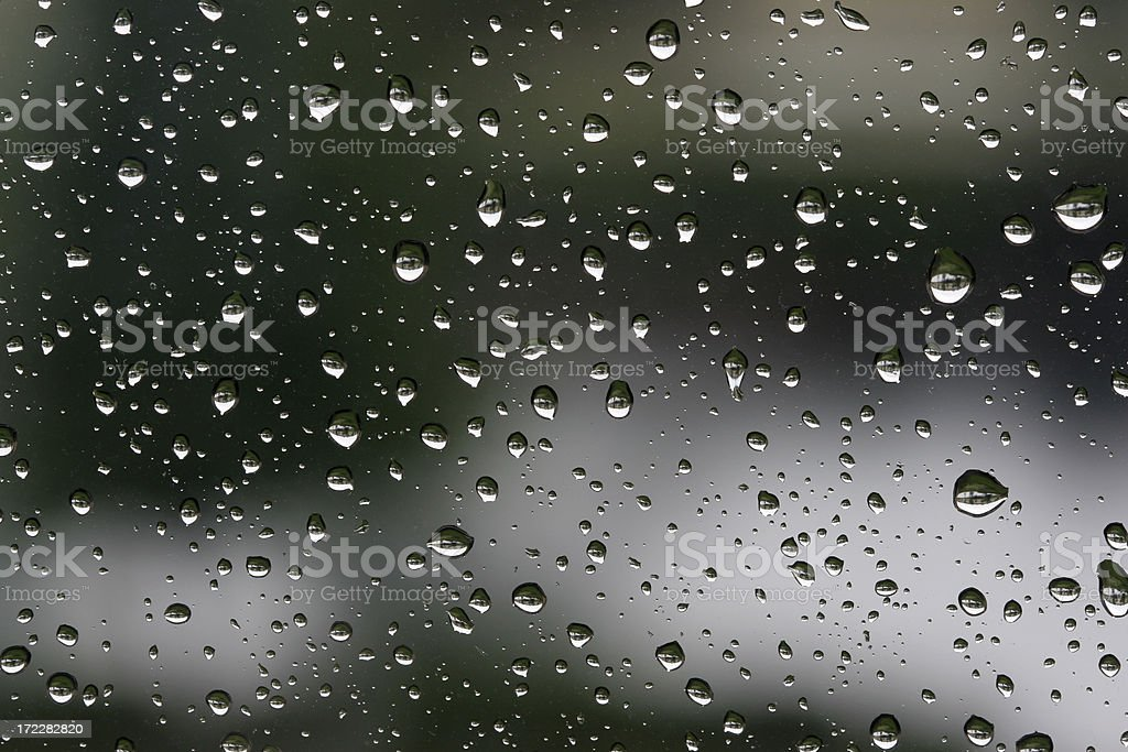 Close-up of water droplets on glass surface, full frame stock photo