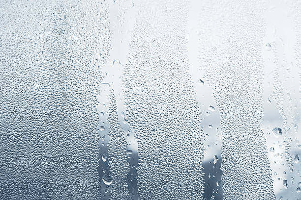 Close-up of water drops on a window stock photo