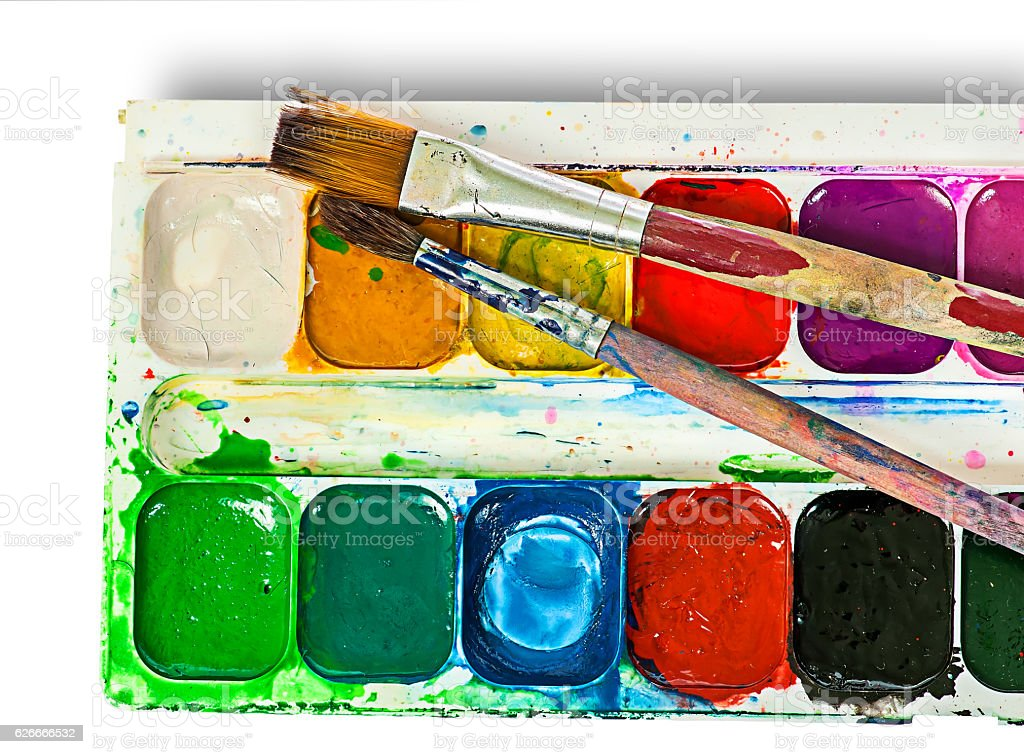 Closeup of watercolor paints set and brushes stock photo