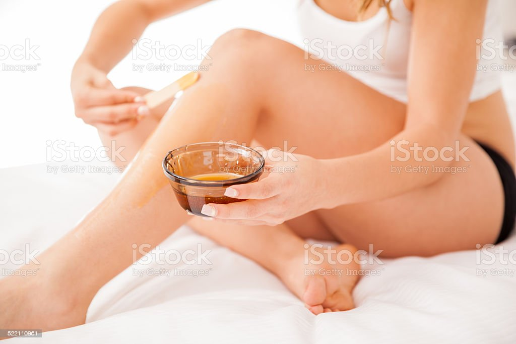 Closeup of wax hair removal stock photo