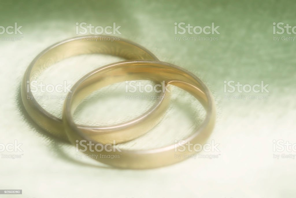 closeup of wedding bands on green background royalty-free stock photo