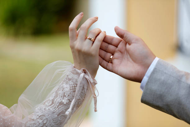 Closeup Of Wedding Couples Hands And Rings stock photo