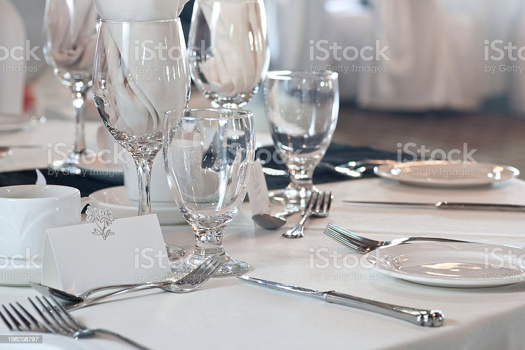 Closeup of wedding placesetting with blank placecard stock photo