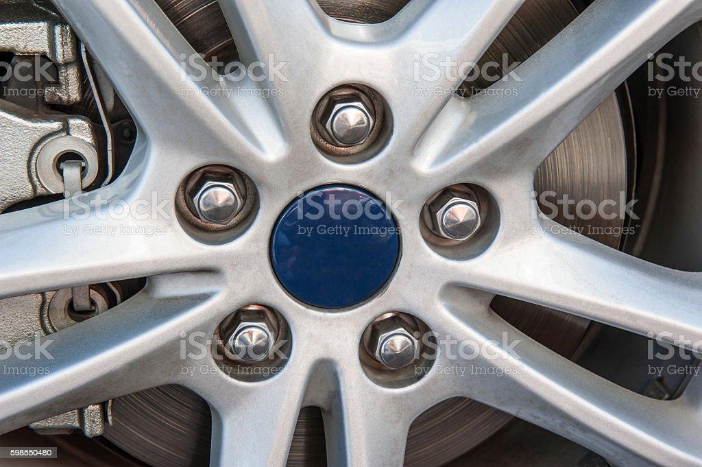 Closeup of wheel hub on car tyre stock photo