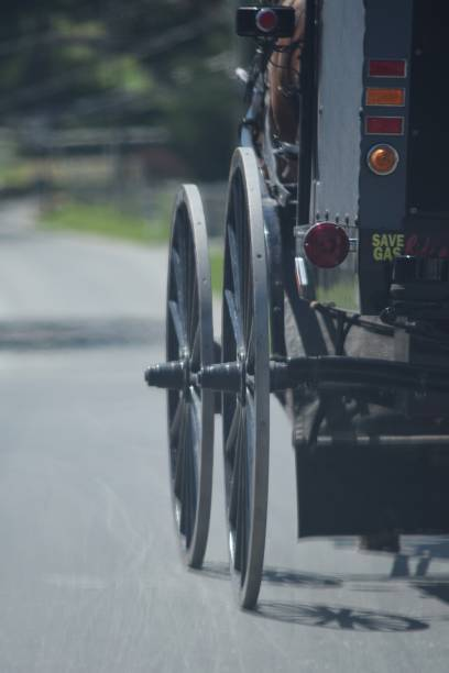 Closeup of wheels on an Amish buggy. stock photo