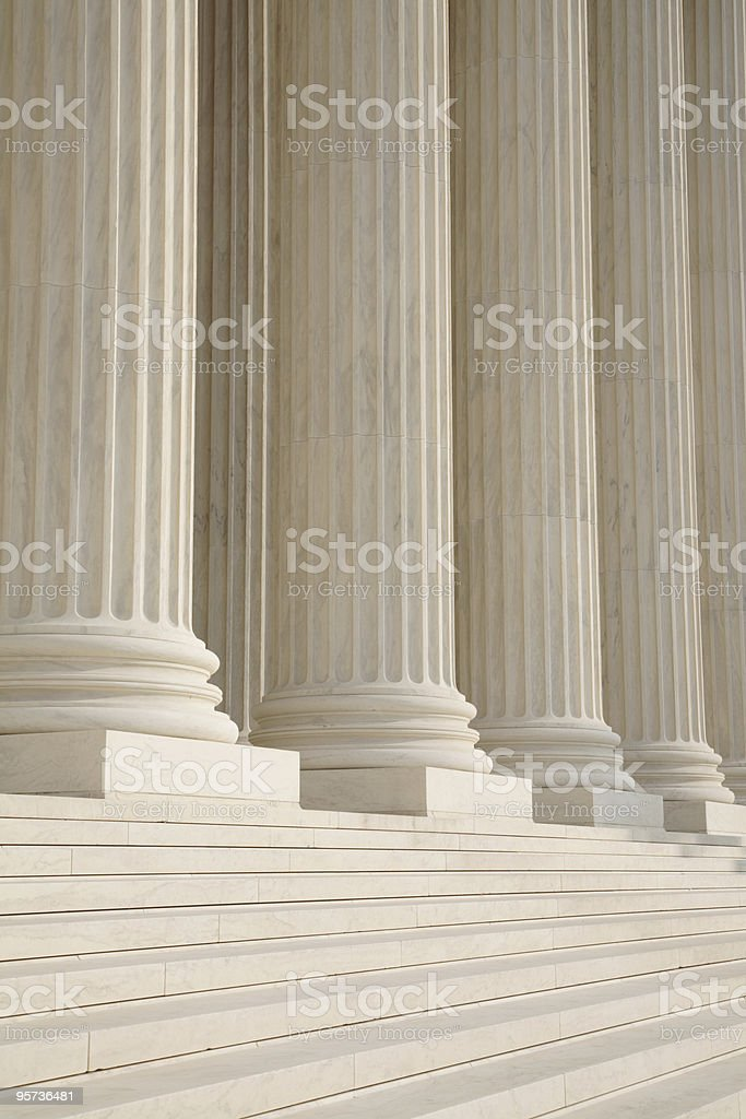 Close-up of white columns and steps stock photo