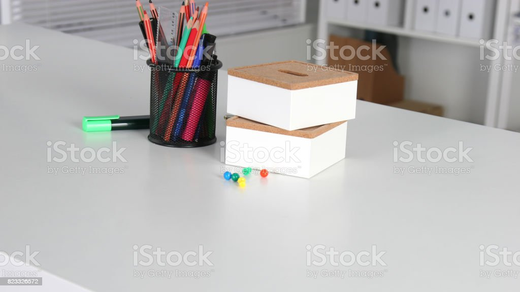 Closeup of white desktop with notepads, pen and other items. Selective focus. stock photo