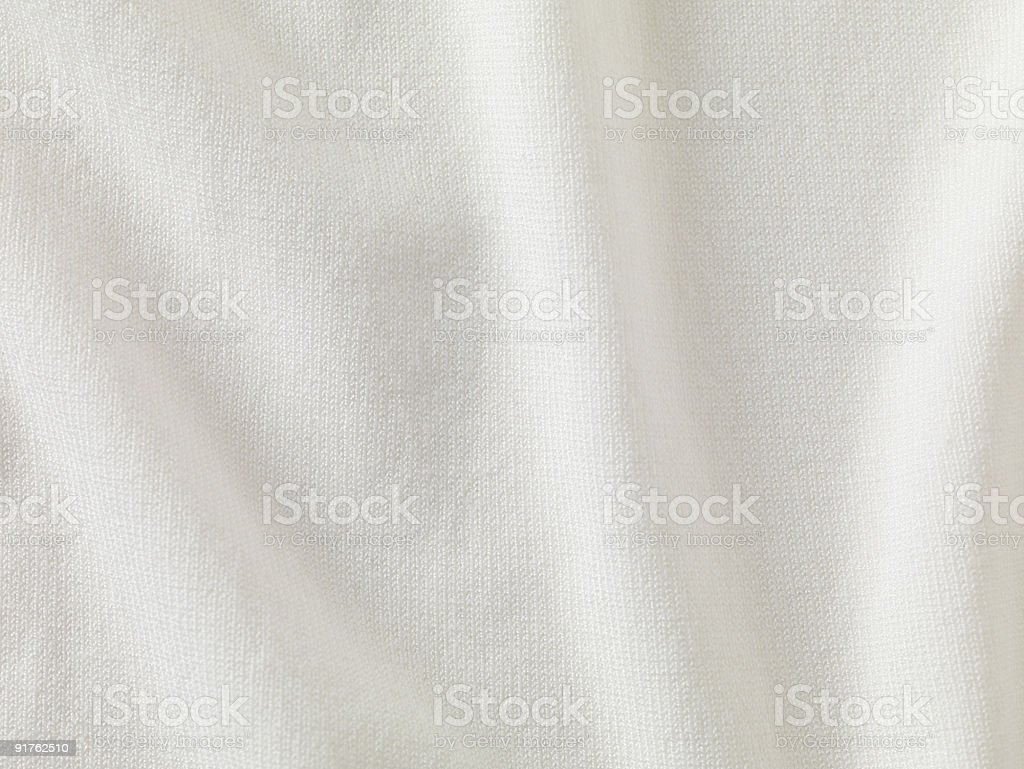 A close-up of white fabric forming a background stock photo