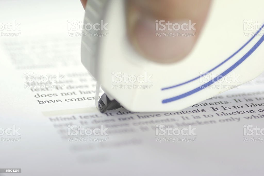 Close-up of white out over mistakes on a document stock photo
