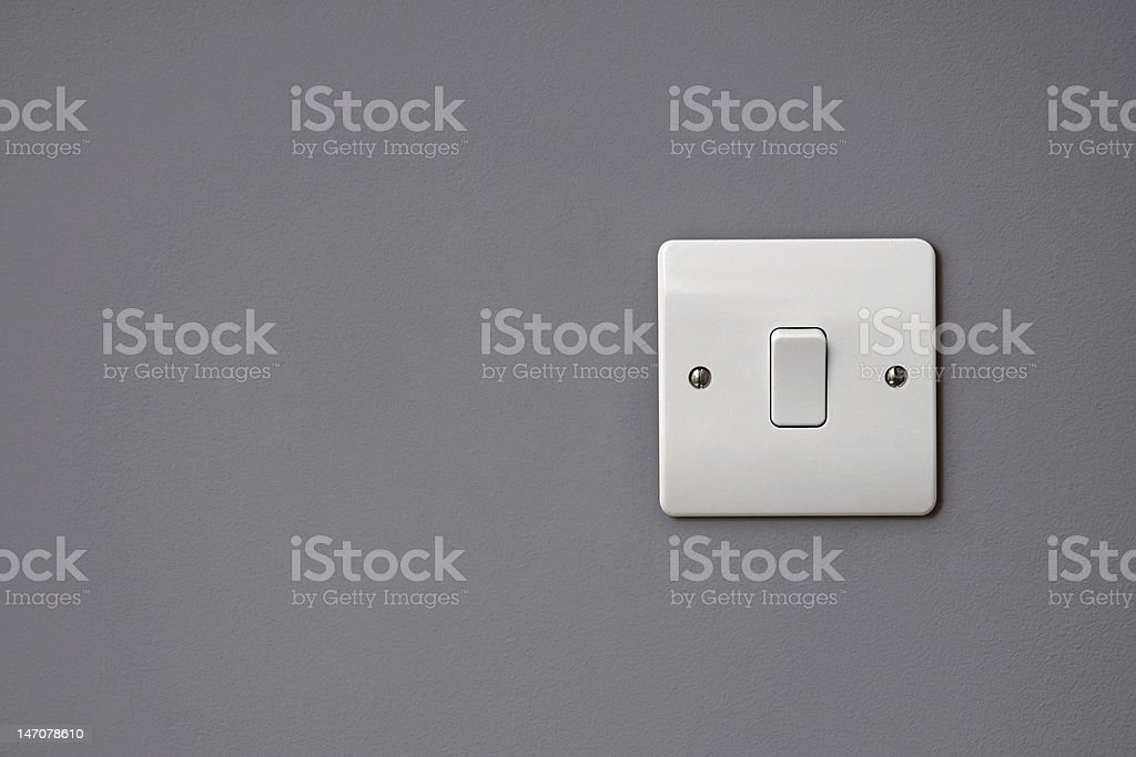 Close-up of white square light switch on the wall stock photo