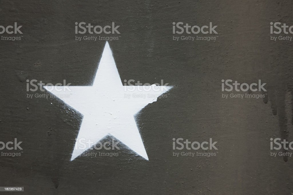 Close-Up of White Star Painted on Military Tank, Background royalty-free stock photo