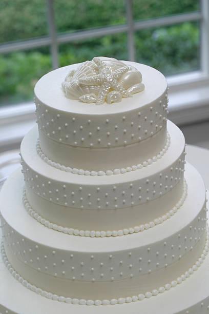 Closeup Of White Wedding Cake stock photo