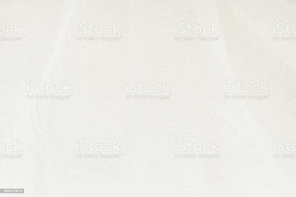 Closeup of white wedding gown. Bottom up view stock photo
