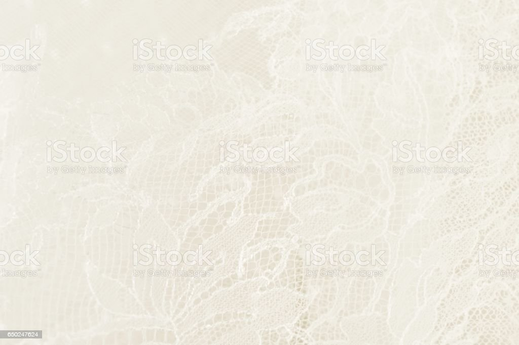 Closeup of white wedding lace with floral pattern stock photo
