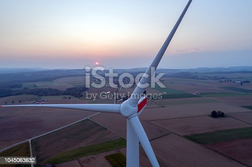 892160114 istock photo Close-up of wind turbine at sunset, aerial view 1045063632