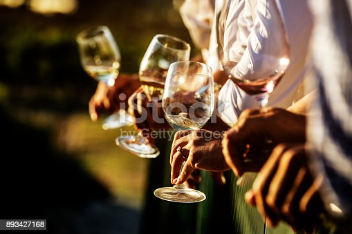 istock Closeup of wine glasses during a celebration 893427168