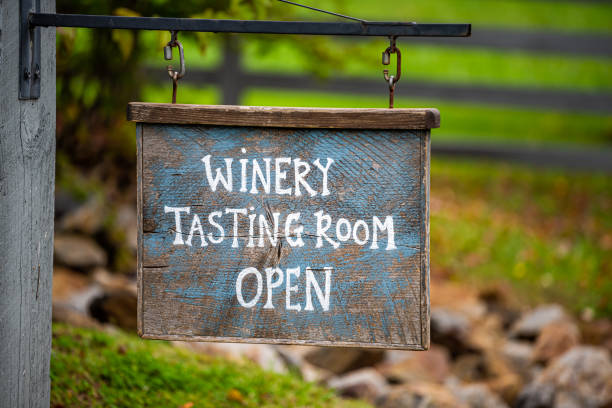 Closeup of Winery Tasting Room Open sign with bokeh background of grape vineyard winery farm landscape stock photo