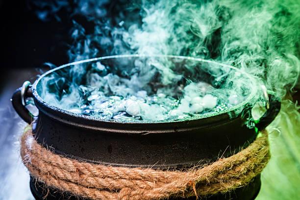 closeup of witcher cauldron with magical mixture for halloween - pfannen test stock-fotos und bilder