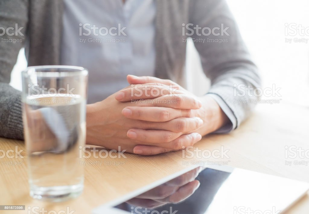 closeup-of-woman-at-table-with-tablet-and-water-picture
