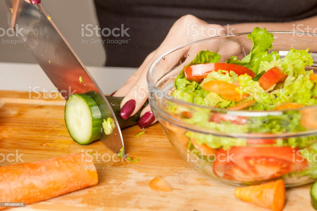 Closeup of woman chopping vegetables for  salad royalty-free stock photo