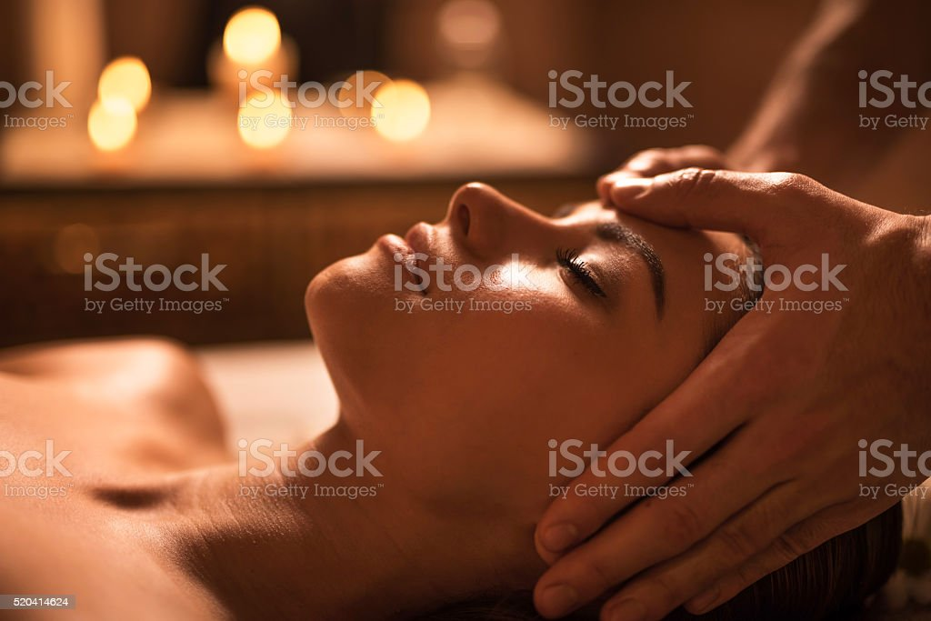 Close-up of woman during facial massage at the spa. stock photo