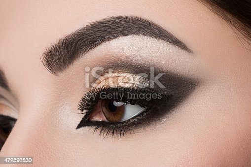 istock Close-up of woman eye with arabic makeup 472593830