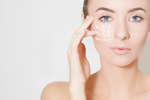 istock Closeup of woman face with  marks on skin for lifting procedure 1128912453