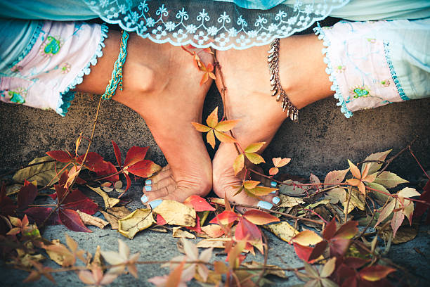 closeup of woman feet in yoga position outdoor stock photo