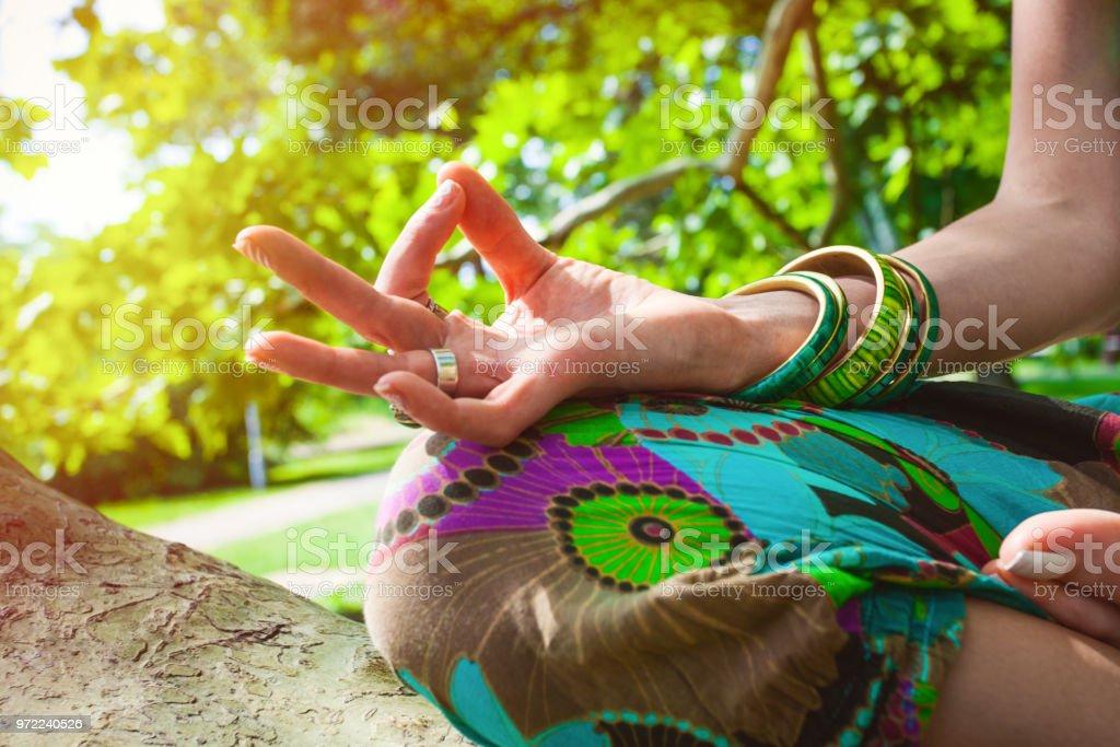 closeup of woman hand in mudra gesture stock photo