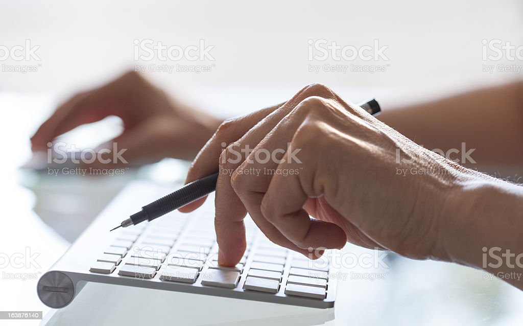 Close-up of woman hands on computer keyboard royalty-free stock photo
