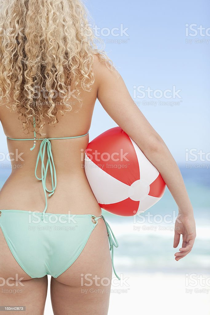 Close-up of woman holding beach ball royalty-free stock photo