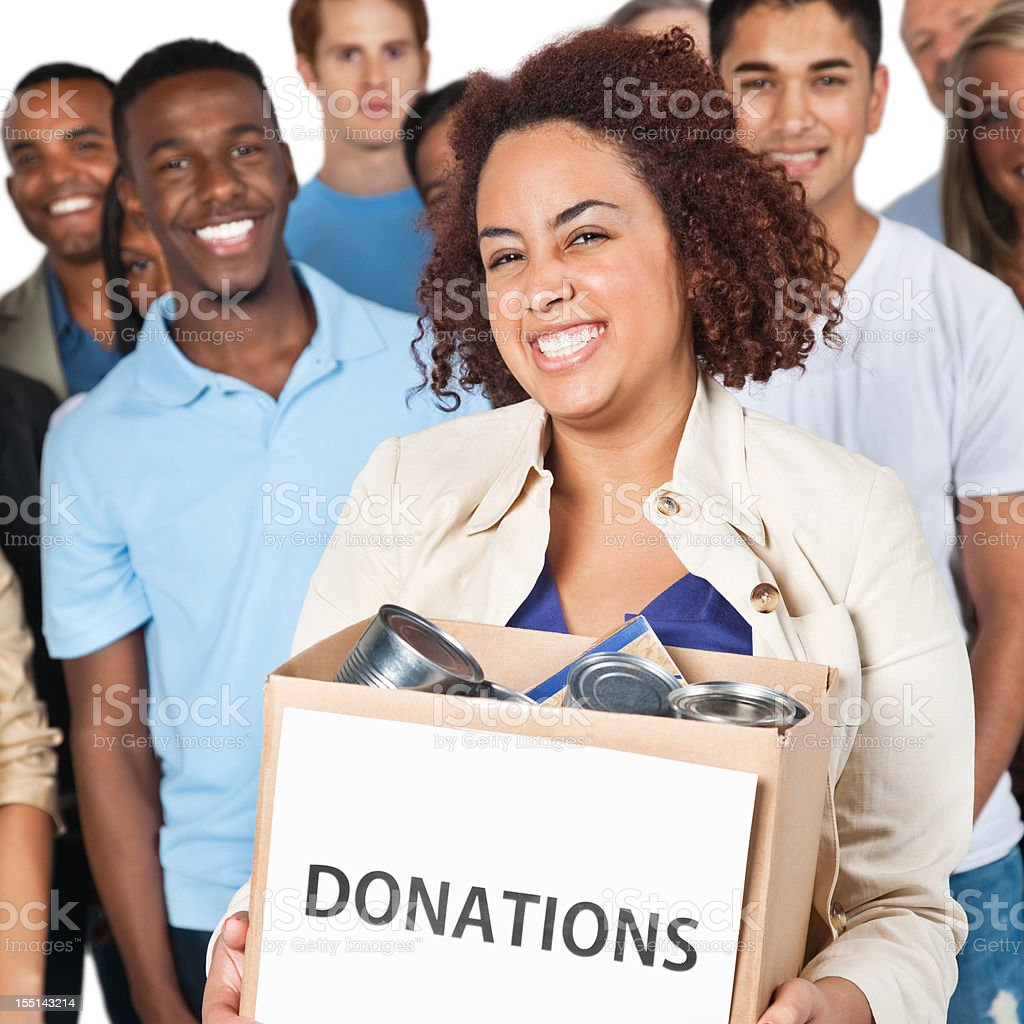Closeup of woman holding donation box with people behind her royalty-free stock photo