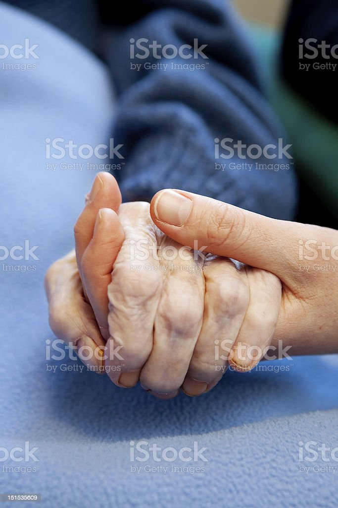 Close-up of woman holding elderly hand stock photo
