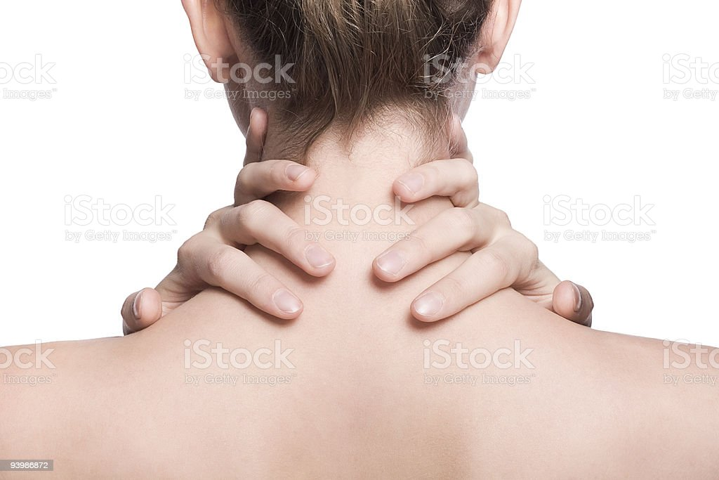Close-up of woman holding her neck royalty-free stock photo